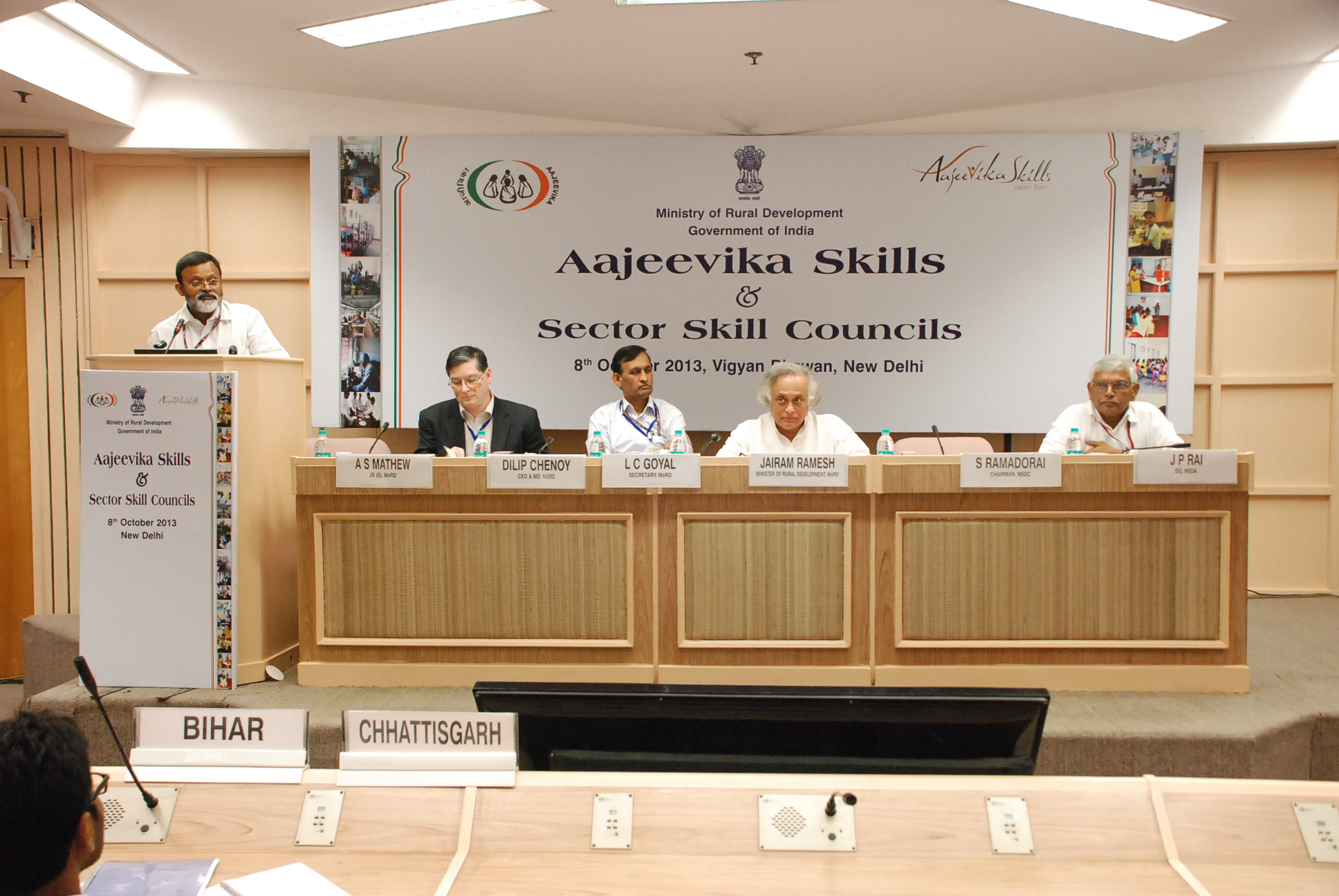 Dr. Santhosh Mathew, JS, (Skills) delivering a speech during Ajeevika Skills and Sector Skill Council