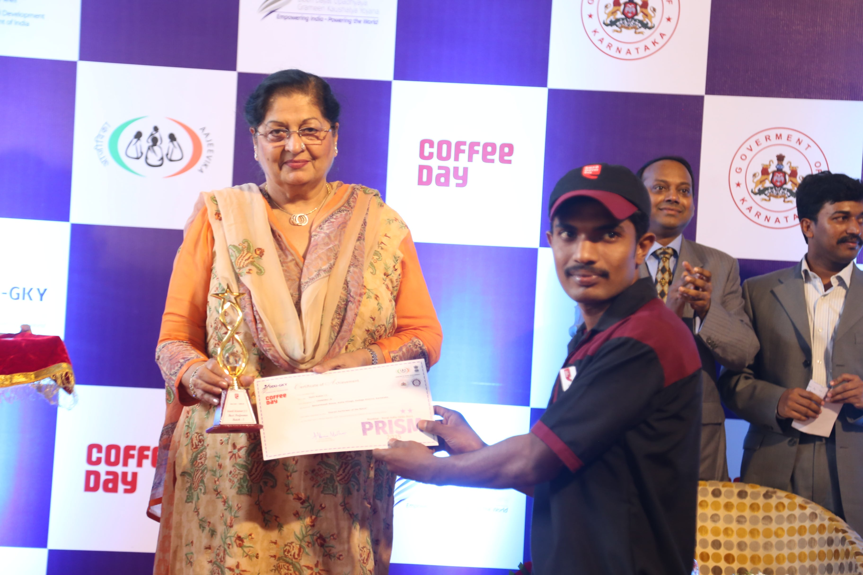 Smt. Prem Lata, MLA (Haryana) presenting Training Certificate to student at CCD Event