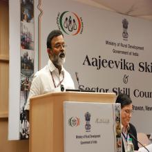 Dr. Santhosh Mathew, JS, (Skills) delivering a speech during Ajeevika Skills and Sector Skill Council (2)