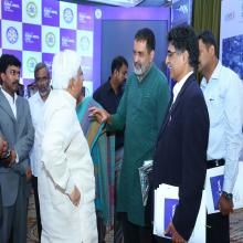 Hon'ble Minister, Shri H K Patil interacting to the  Shri T.V. Mohandas Pai, Chairman of Manipal Global Education-2